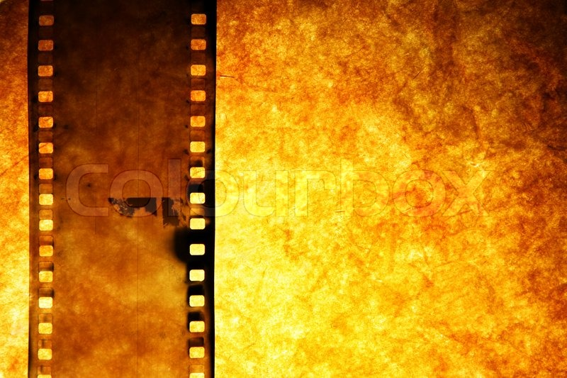 old film strip over grunge paper background stock photo