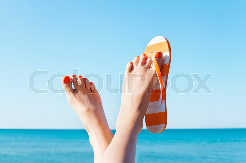 33463e1dfea88c Young girl feet in colorful flipflop ...