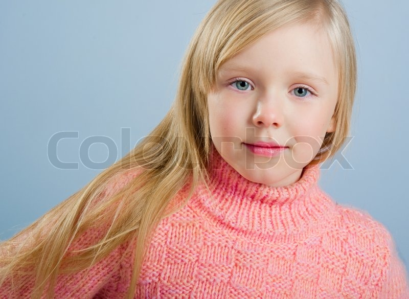 Cute Little Girl With Long Hair On A Grey Background Stock Photo