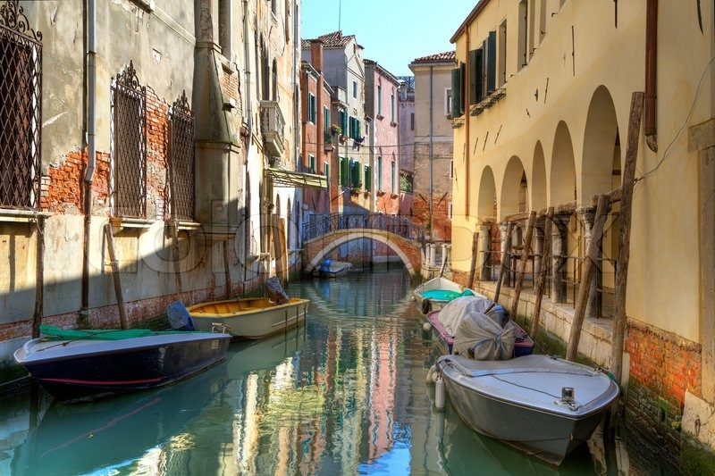 Boats on small canal among old old houses in Venice, Italy | Stock Photo | Colourbox