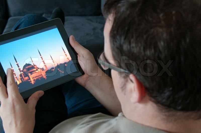 2579926-633778-middle-aged-man-sitting-comfortably-on-a-sofa-and-checking-a-digital-tablet-pc.jpg