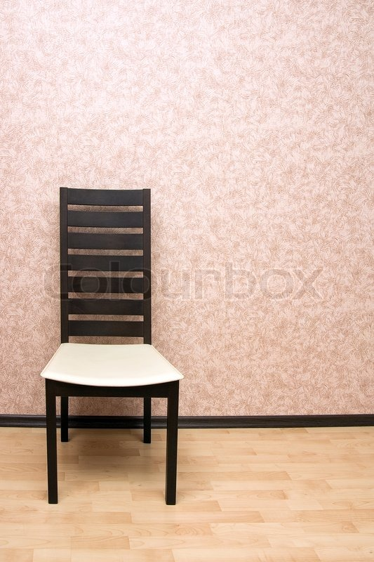 Modern Wooden Chair Against A Wall Stock Photo Colourbox