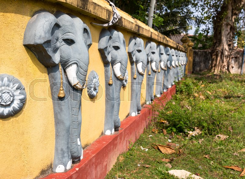 Wall with elephant sculptures in buddha temple, Ceylon attractions, unesco heritage. Asia culture, bubbhism religion, stock photo
