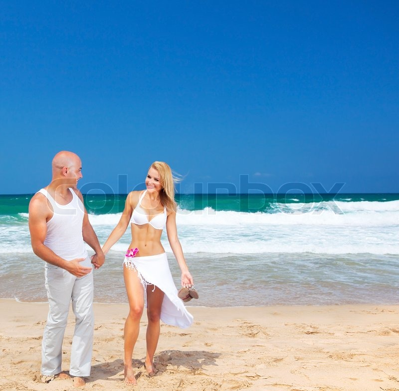 Happy Couple Walking On The Beach Young New Family Spends Honeymoon At Tropical Resort Holding Hands Handsome Man Beautiful Woman In Love