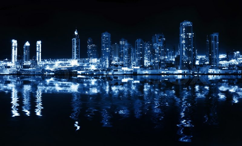 Stock image of 'City at night, panoramic scene of downtown reflected in water, Dubai'