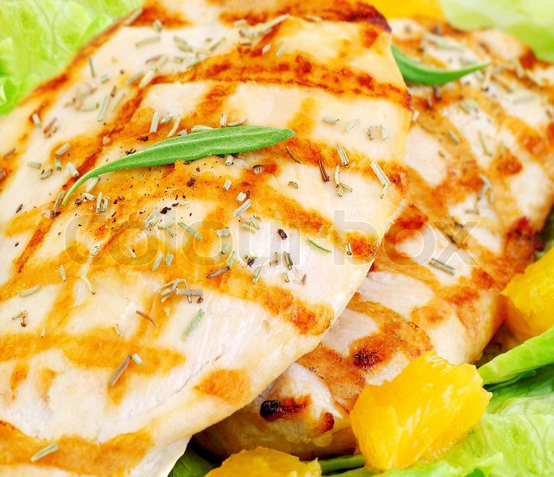Stock image of 'Grilled chicken fillet with rosemary and orange, tasty ...