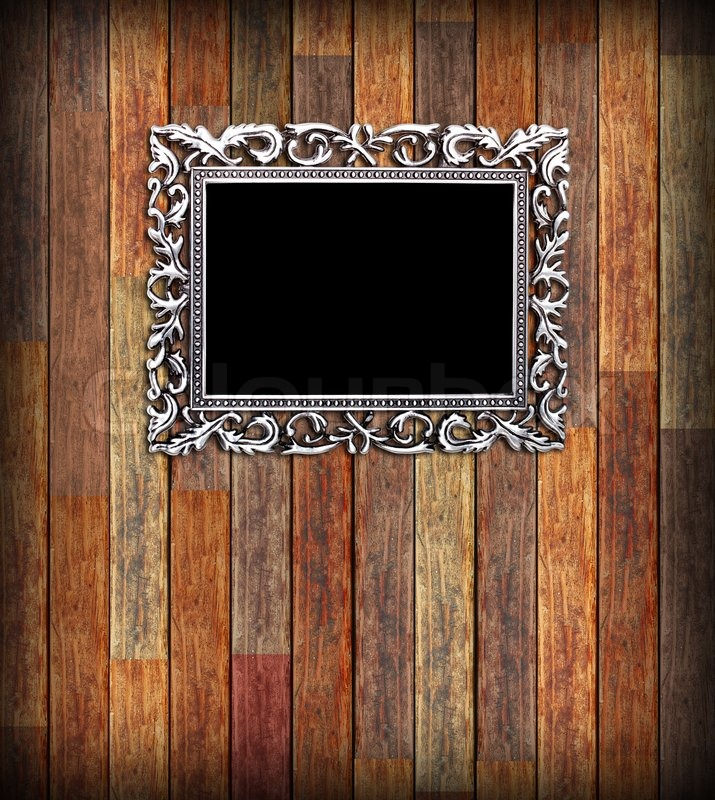 Empty Silver Frame On A Wood Wall Stock Photo Colourbox