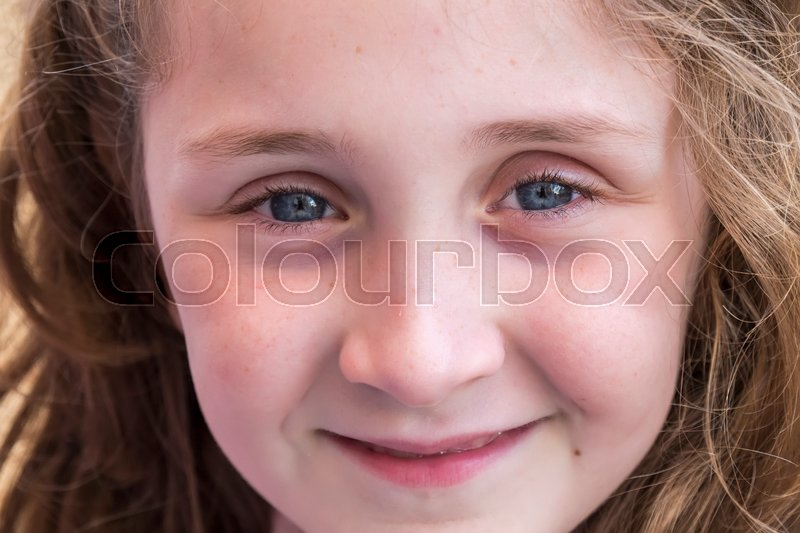 Face beautiful girl smiling in foreground, stock photo