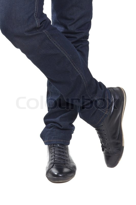 Menneskets fødder i blå bukser og | Stock foto | Colourbox