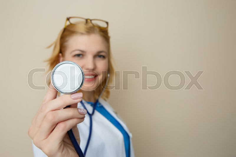 Beautiful doctor with phonendoscope in medical dressing gown on ...