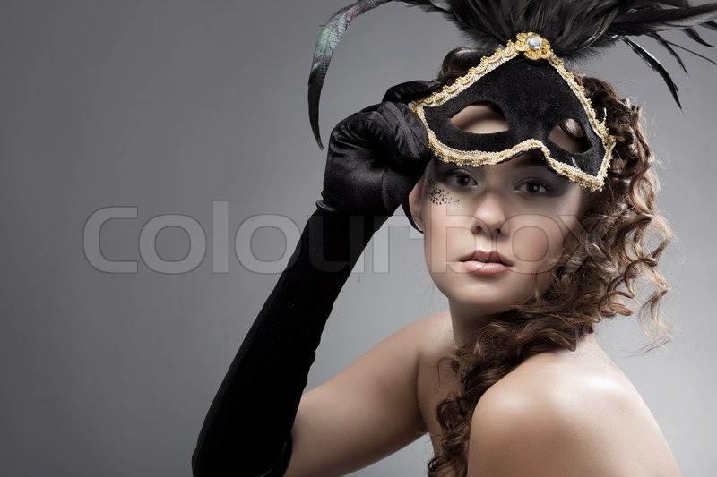Stock image of 'Beautiful woman wearing masquerade costume and mask'