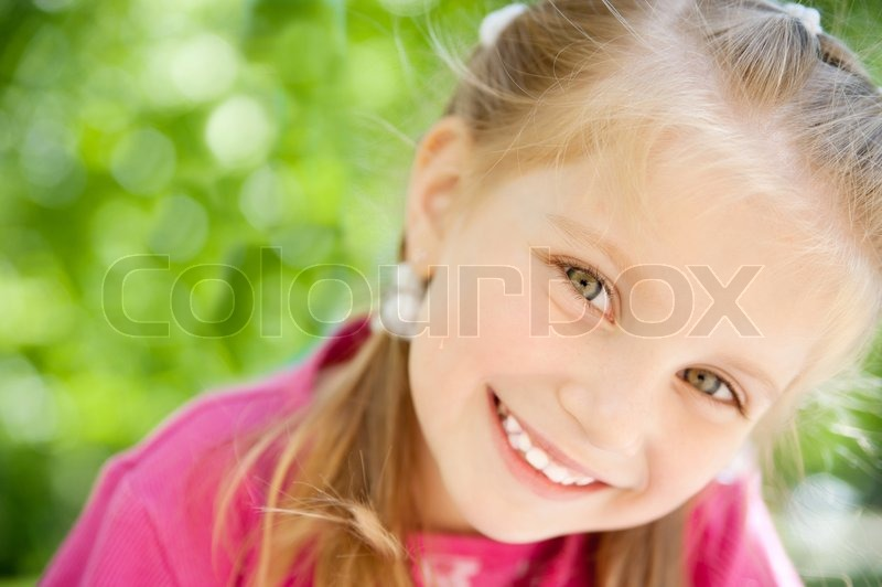 Cute little girl smiling in a park close up stock photo colourbox - Pics of small little girls ...