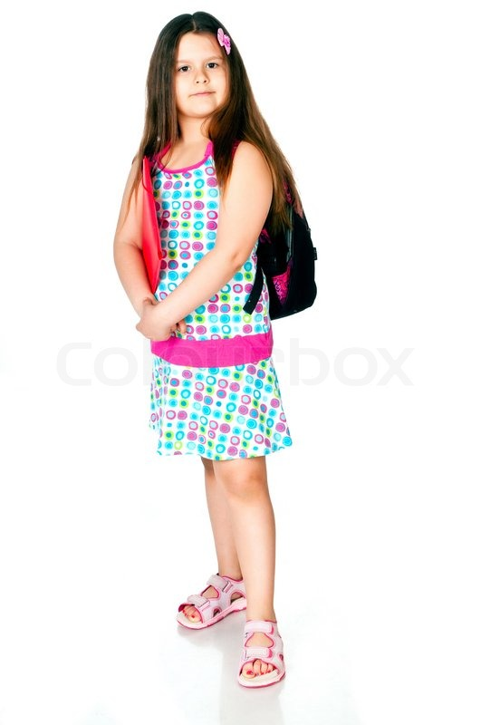 Little girl with notebooks and school bags