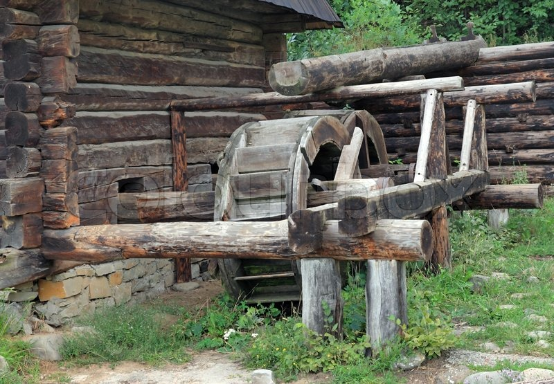 Old wood log water mill in historical country homestead for Mill log