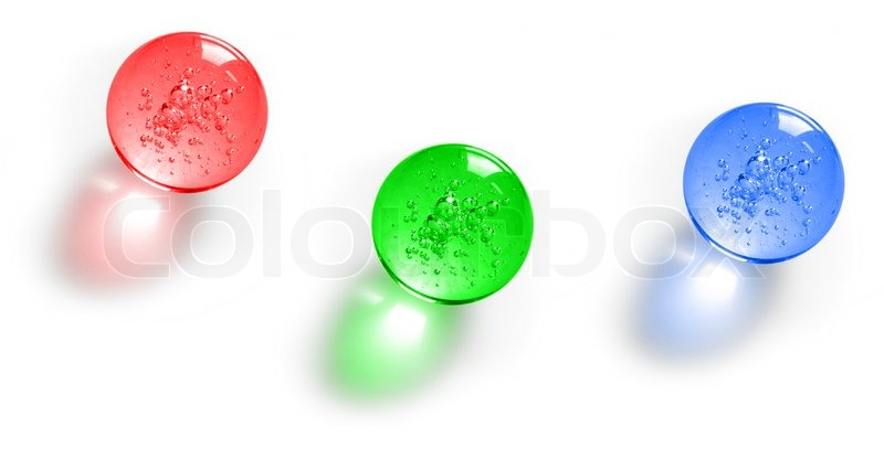 Three Color Glass Balls With Bubbles Inside Stock Photo