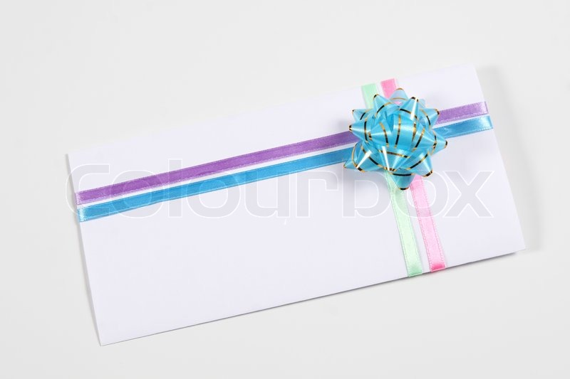 An envelope decorated with a colorful ribbons | Stock Photo ...