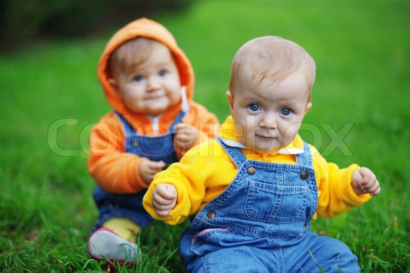 Cute Twins Babies Sitting On Fresh Stock Photo Colourbox