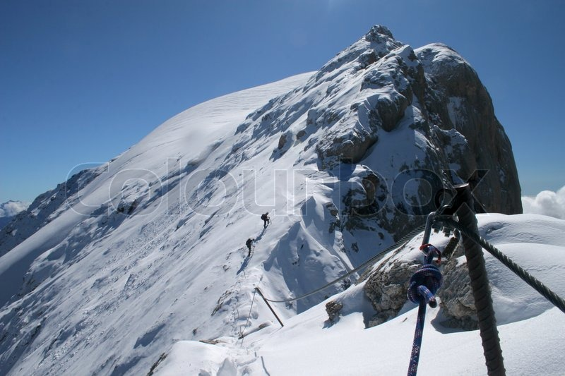 Extreme sport - Mountaneering in winter, stock photo