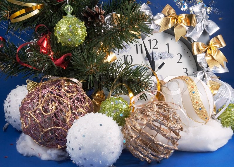 Festive Christmas composition with clock, various holiday balls and other adornments, stock photo