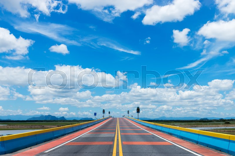 White cloud on the sky at Empty road and colorful the traffic lines, stock photo