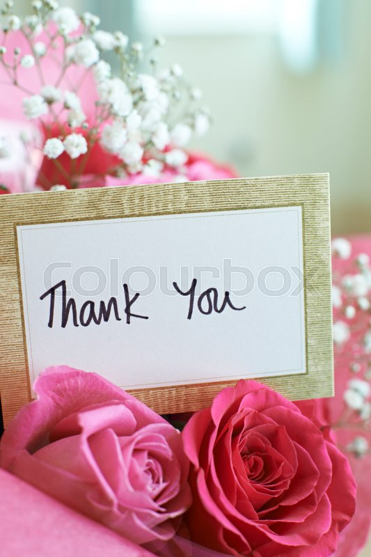 Thank You Card In Bouquet Of Flowers, stock photo