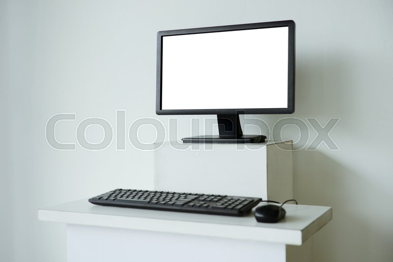 Mock up of computer screen on white table, stock photo