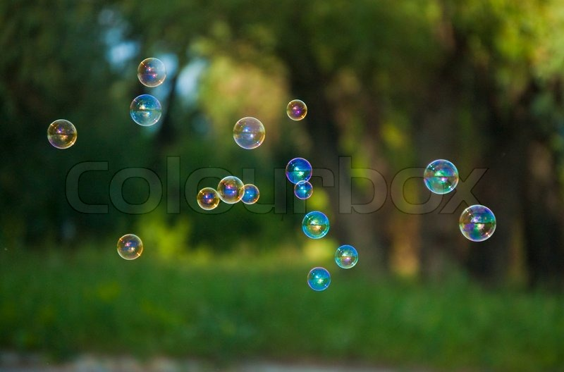 A Lot Of Soapbubbles On The Blur Nature Background Stock Photo