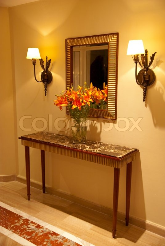 foyer table at home entrance with flowers and mirror stock photo - Foyer Table