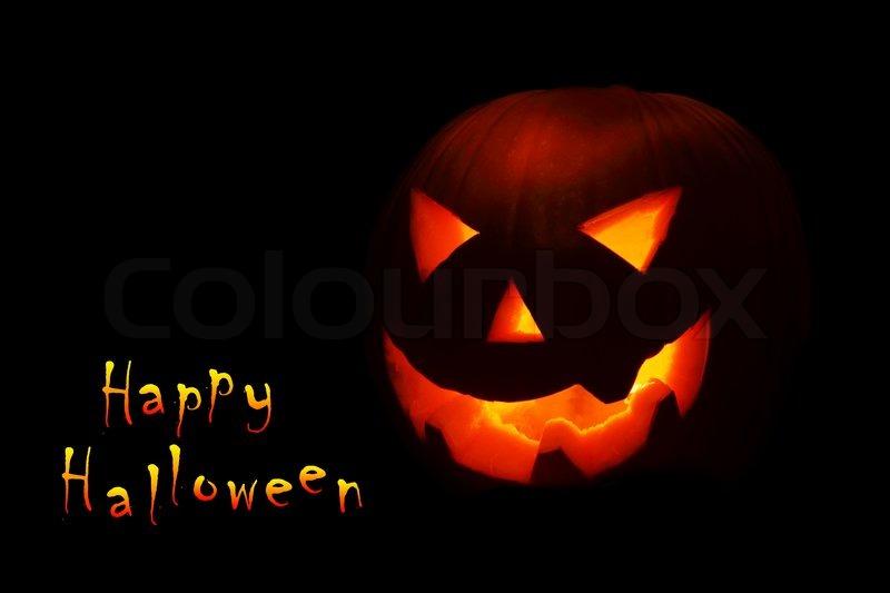 halloween nightmare with glowing jack o lantern in the darkness stock photo - Halloween Nightmare