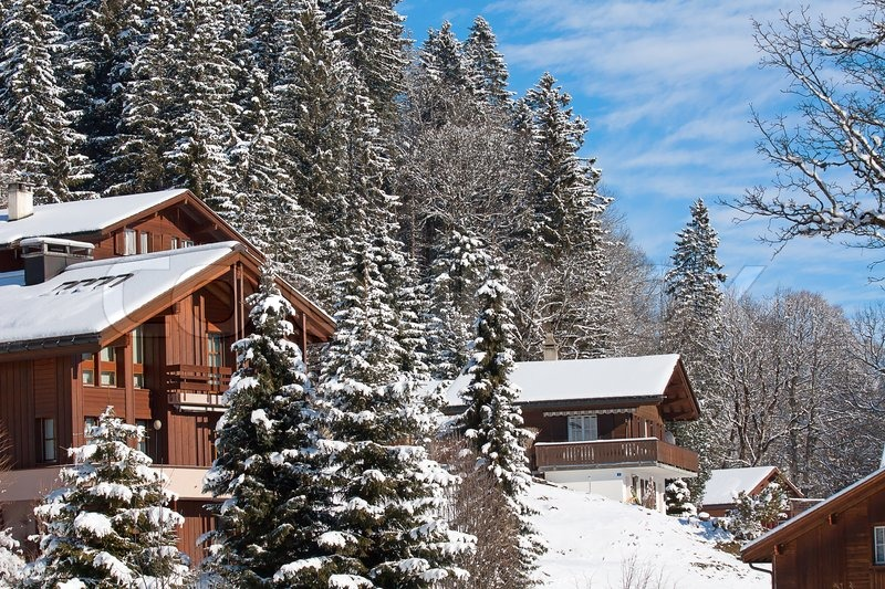Winter Holiday Houses In Swiss Alps Stock Photo Colourbox