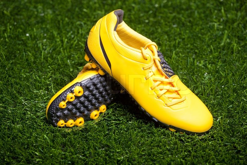 840769d5172 Pair of soccer shoes on grass field