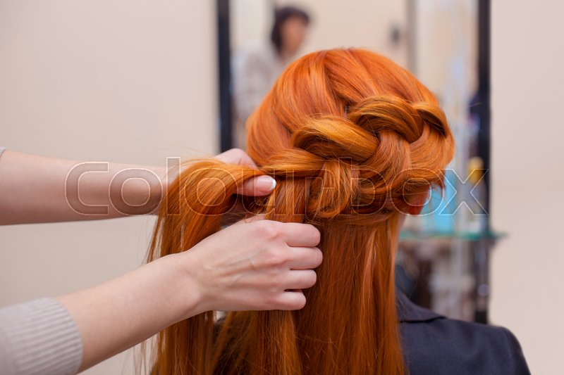 Beautiful Red Haired Girl With Long Hair Hairdresser Weaves A