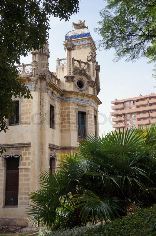 A historic building among plants in spain, stock photo