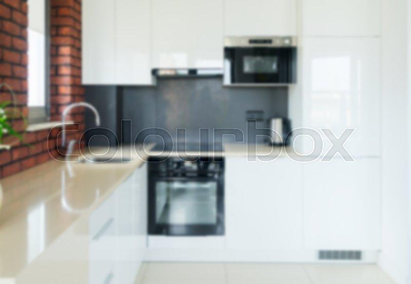 Blured modern white bright kitchen background, stock photo