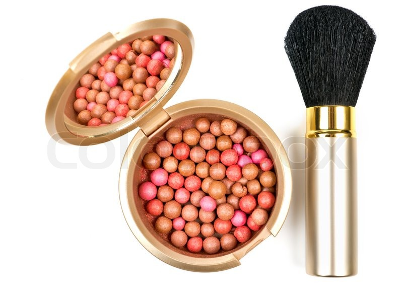 bronzing pearls in powder box with mirror and make up brush over