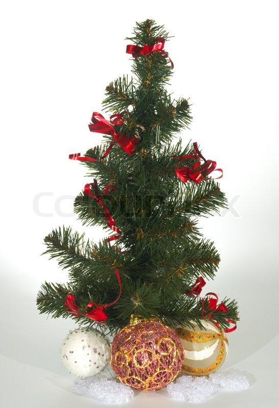 kleine k nstliche gr ne weihnachtsbaum und dekorative kugeln stockfoto colourbox. Black Bedroom Furniture Sets. Home Design Ideas