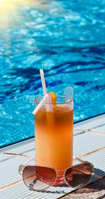 Sunglasses And Tasty Cocktail With Lemon Next To Swimming Pool Stock Photo Colourbox
