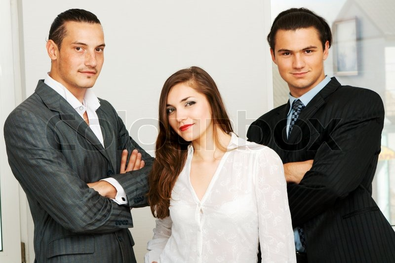 successful business team of two men and one woman stock photo