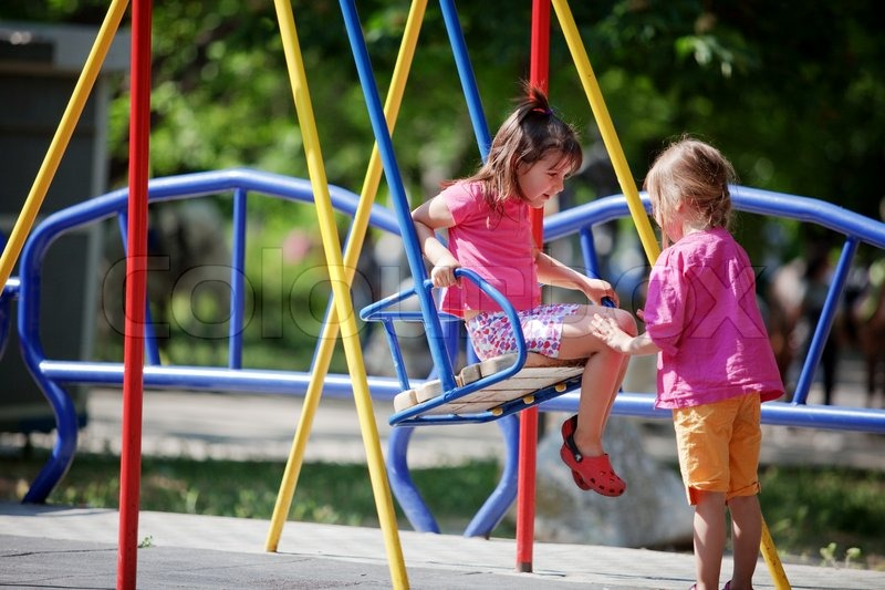Children playing on playground in park | Stock Photo ...