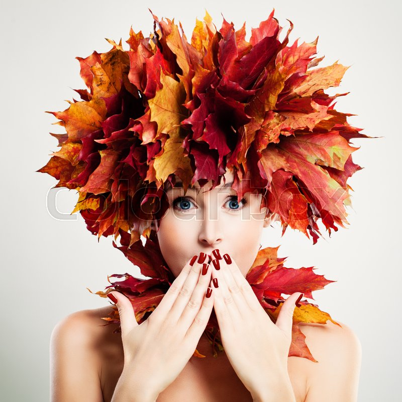 Surprised Woman with Autumn Leaves. Surprise and Fun, stock photo
