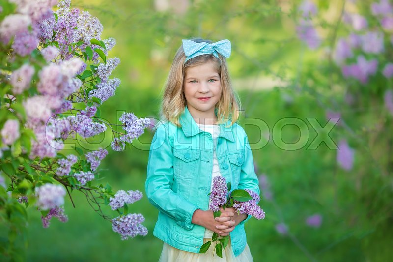 Cute girl in blue jackets with fairy airy skirt standing close to ...