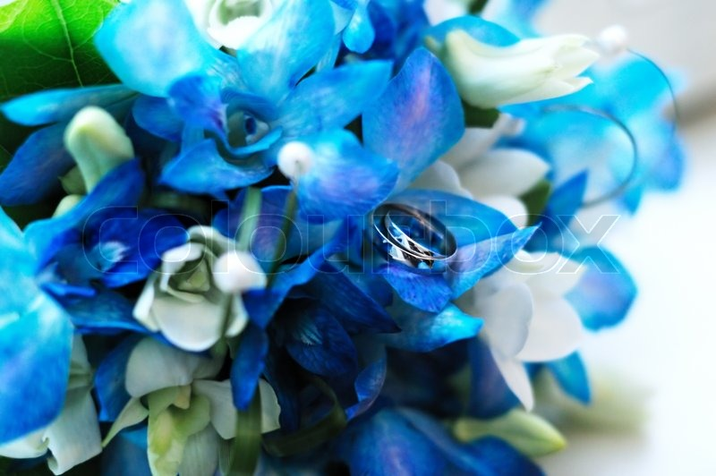 Two wedding rings on a wedding azure flowers bouquet | Stock Photo ...
