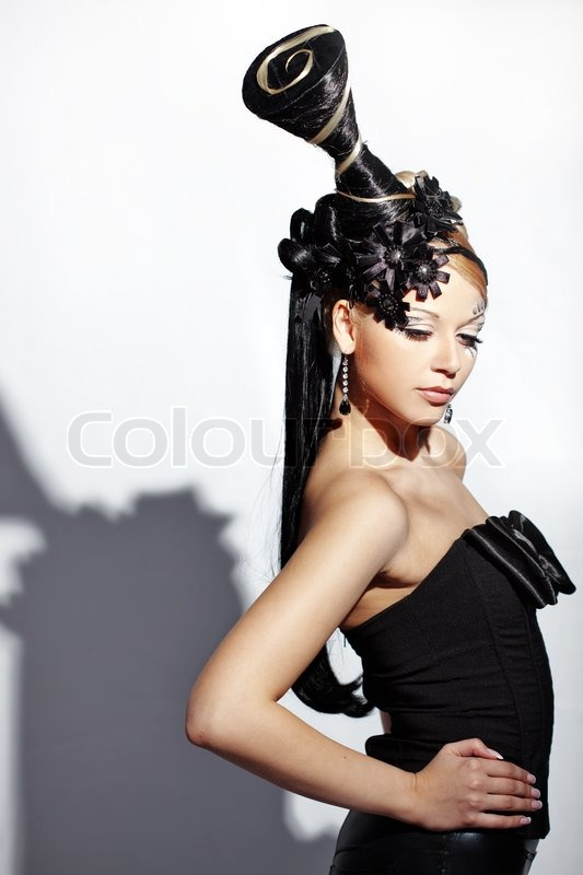 Portrait of stylish woman with fantasy hairstyle and make-up ...