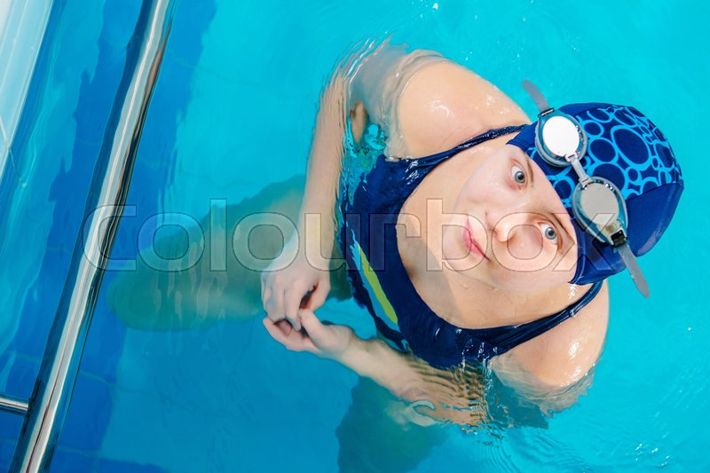 Young Caucasian Girl in the Swimming Pool. Top View Closeup. Children Recreation, stock photo