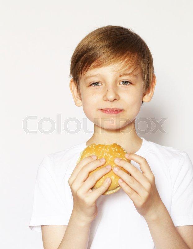 cute blonde boy eating cheeseburger