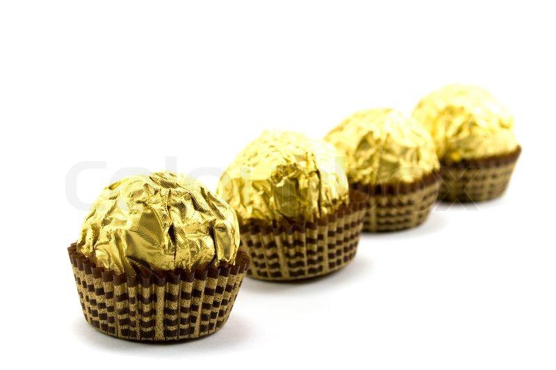 Gold chocolate ball on white | Stock Photo | Colourbox