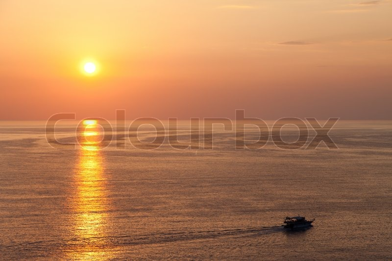 Stock image of 'Summer vacations - water travel ship or boat sailing blue sea waves on sunset'