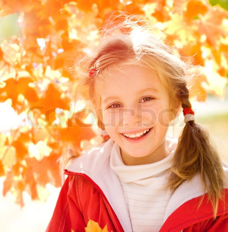 Stock image of 'Autumn portrait of cute little caucasian girl'