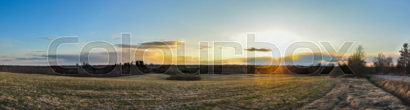 Panorama landscape. Sunset above the field and forests, stock photo