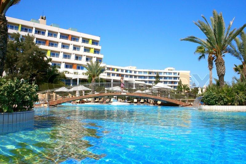 Beautiful swimming pool with bridge on ... | Stock image ...